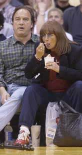 penny marshall and jim belushi eating