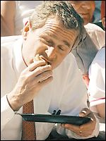 George W Bush eating