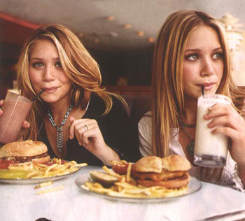 Mary Kate and Ashley Olsen eating
